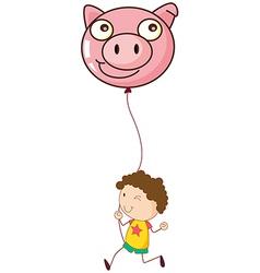 A boy holding a pig balloon vector image