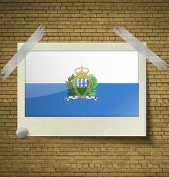 Flags san marinoat frame on a brick background vector