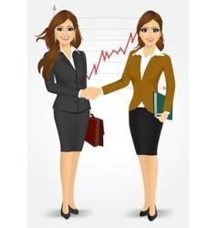 two businesswomen shaking hands vector image