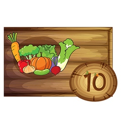 A wooden frame with ten vegetables vector image
