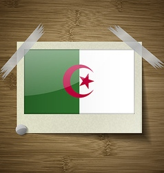 Flags algeria at frame on wooden texture vector
