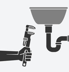 plumber with wrench repairing a leaking pipe vector image