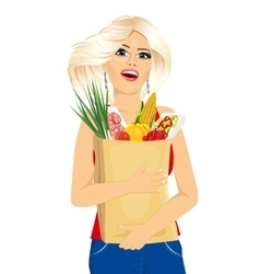 young woman carrying grocery paper bag vector image vector image