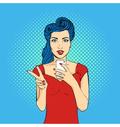 Pop art woman face with open mouth holding a phone vector