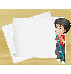 A boy holding a pencil beside the empty papers vector image