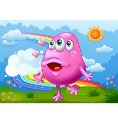 A happy pink monster dancing at the hilltop with a vector