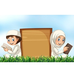 Muslim couple reading bible on the grass vector