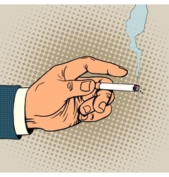 Hand with a smoking cigarette vector