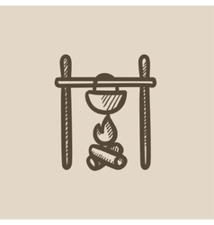 Cooking in cauldron on campfire sketch icon vector