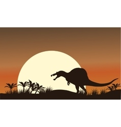 Silhouette of spinosaurus and big sun vector