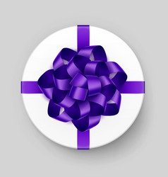 white round gift box with purple bow and ribbon vector image