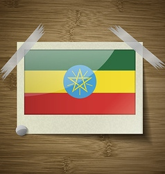 Flags ethiopia at frame on wooden texture vector