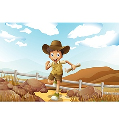 A young explorer running with a map in his hand vector image vector image