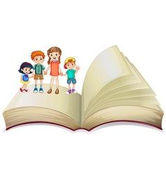 Children standing on big book vector image