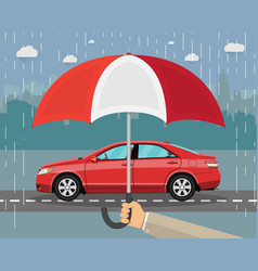 Hand with umbrella that protects car vector