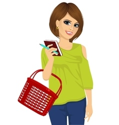 Attractive woman holding shopping basket vector