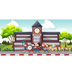 Children marching in front of school vector