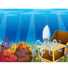 A treasure box under the sea with an octopus vector image