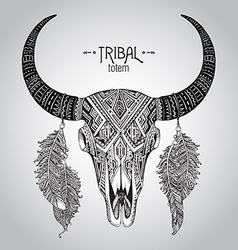 Hand drawn of bull skull with feathers vector