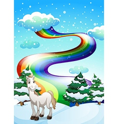 A horse in a snowy area and a rainbow in the sky vector