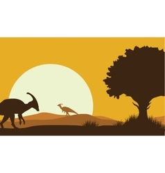 Silhouette of parasaurolophus with sun vector
