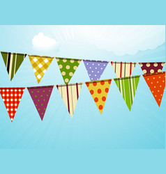 Vintage colorful bunting over sky background vector