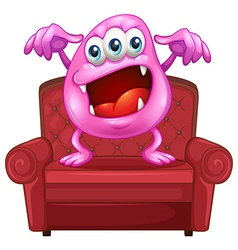 A chair with a pink monster vector