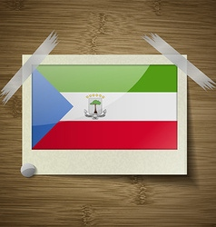 Flags equatorial guinea at frame on wooden texture vector