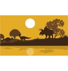Silhouette of triceratops and parasaurolophus vector