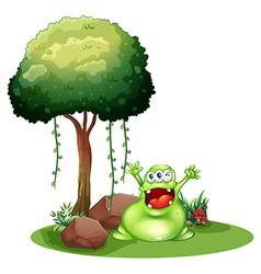 A happy monster near the tree vector image