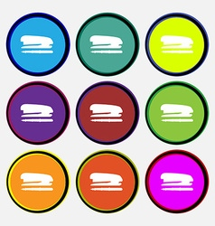 Stapler and pen icon sign Nine multi colored round vector image