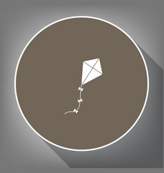 kite sign white icon on brown circle with vector image vector image