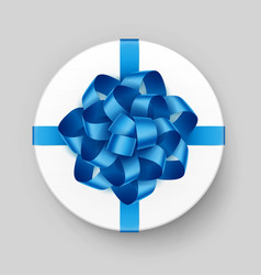 White round gift box with shiny blue bow vector