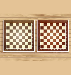 Set of chess boards on wooden background vector