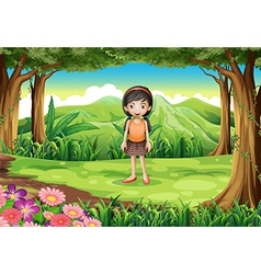 A jungle with a cute little girl vector