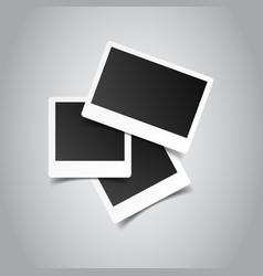 Blank retro photo frames on grey background vector