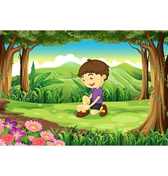 A smiling young boy in the middle of the forest vector