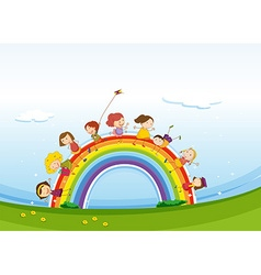 Children standing over the rainbow vector image