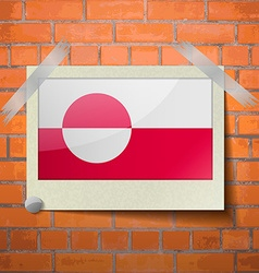 Flags greenland scotch taped to a red brick wall vector