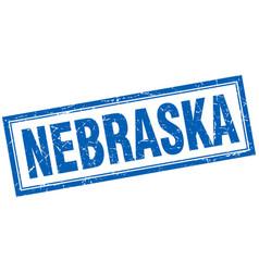 Nebraska blue square grunge stamp on white vector