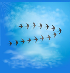 flock of swallows in blue sky with clouds birds vector image
