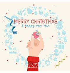 Hand holding a ball for christmas vector image
