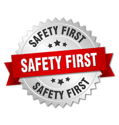 Safety first 3d silver badge with red ribbon vector