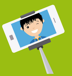 Young boy making a photo with stick selfie vector