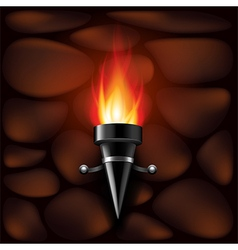 Fire torch on stone wall background vector