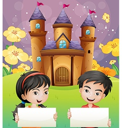 Two kids with empty signages standing in front of vector image vector image