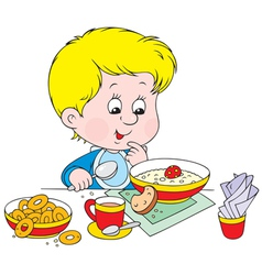 Boy at breakfast vector