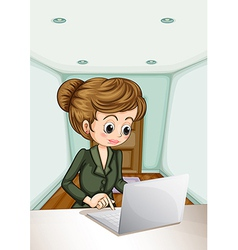 A serious businesswoman using the laptop vector image