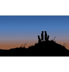 Meerkat silhouette in the hills vector