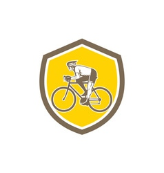 Cyclist riding mountain shield retro vector